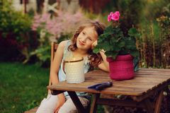 Happy romantic child girl dreaming in evening summer garden stock image