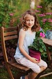 Happy romantic child girl dreaming in evening summer garden royalty free stock photos
