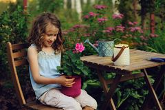 Happy romantic child girl dreaming in evening summer garden Stock Photo
