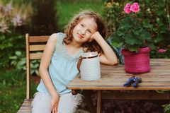 Happy romantic child girl dreaming in evening summer garden stock photography
