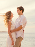 Happy romantic couple on the beach at sunset Stock Photography