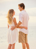 Happy romantic couple on the beach at sunset Royalty Free Stock Image
