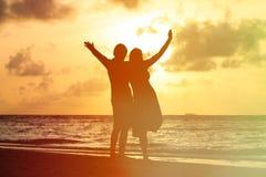 Happy romantic couple on the beach at sunset Stock Photos