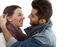 Happy romantic couple embracing kissing Stock Photography