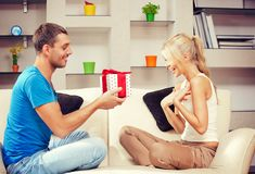 Happy romantic couple with gift royalty free stock photography