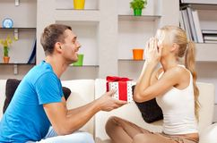 Happy romantic couple with gift Stock Images
