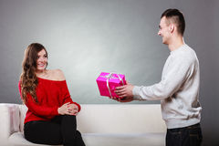 Happy romantic couple with gift Stock Photography