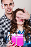 Happy romantic couple with gift Stock Image