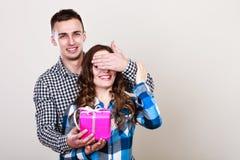 Happy romantic couple with gift Stock Photo