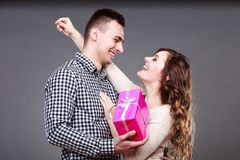 Happy romantic couple with gift Royalty Free Stock Images