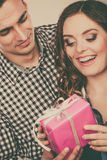 Happy romantic couple with gift Royalty Free Stock Image