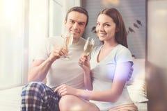 Happy romantic couple having a little celebration royalty free stock images