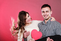 Happy romantic couple with heart Stock Photo