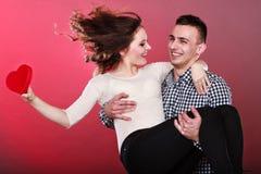 Happy romantic couple with heart Royalty Free Stock Photos