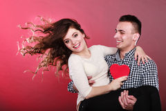 Happy romantic couple with heart Stock Photos