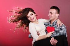 Happy romantic couple with heart Stock Photos