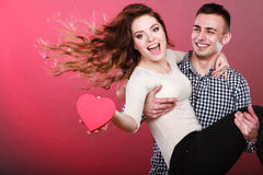 Happy romantic couple with heart Stock Images