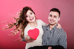 Happy romantic couple with heart Stock Image