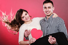 Happy romantic couple with heart Royalty Free Stock Photos