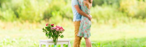Happy Romantic couple hugging. Focus on flowers. selective focuse.  Stock Photos