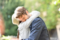 Happy romantic couple hugging in park Stock Images