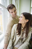 Happy romantic couple looking at each other at home Royalty Free Stock Images