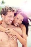 Happy romantic couple lovers on beach honeymoon Royalty Free Stock Images