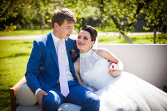 Happy, romantic couple of newlyweds posing & hugging on white so Stock Images