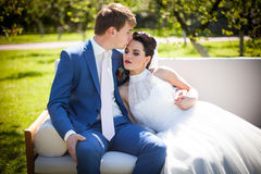 Happy, romantic couple of newlyweds posing & kissing on white so Stock Photography