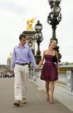 Happy romantic couple in Paris. Crossing the Pont Alexandre III Stock Photos
