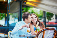 Happy romantic couple in Parisian cafe Stock Images