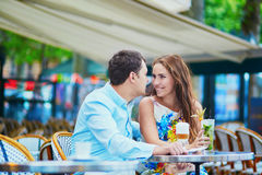 Happy romantic couple in Parisian cafe Royalty Free Stock Images