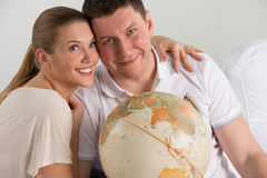 happy romantic couple planning their vacation Stock Image