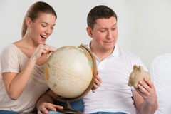 Happy romantic couple planning their vacation Royalty Free Stock Photography