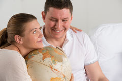 Happy romantic couple planning their vacation Stock Photography