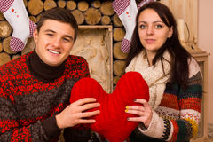 Happy romantic couple with a red heart Stock Image
