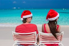 Happy romantic couple in red Santa Hats at Royalty Free Stock Photo