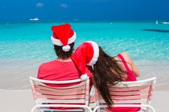 Happy romantic couple in red Santa Hats at Stock Photography