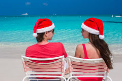 Happy romantic couple in red Santa Hats at Royalty Free Stock Image