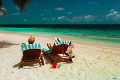 Happy romantic couple relax on a tropical beach. Vacation Stock Image