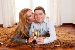 Happy Romantic couple on Rug Stock Photos
