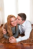 Happy Romantic couple on Rug Stock Images