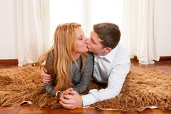 Happy Romantic couple on Rug Royalty Free Stock Images