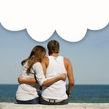 Happy romantic couple at sea coast with dialogue box above them Stock Image