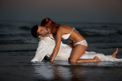 Happy, romantic couple, by the sea shore Royalty Free Stock Image