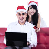 Happy romantic couple shopping online Royalty Free Stock Photos