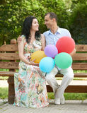 Happy romantic couple sit on bench in city park and posing, summer season, adult people man and woman Stock Images