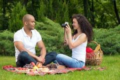 Happy romantic couple taking pictures on picnic Stock Photo