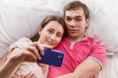 Happy Romantic Couple Taking Pictures Using Phone Stock Photos