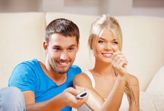 Happy romantic couple with TV remote Royalty Free Stock Photography